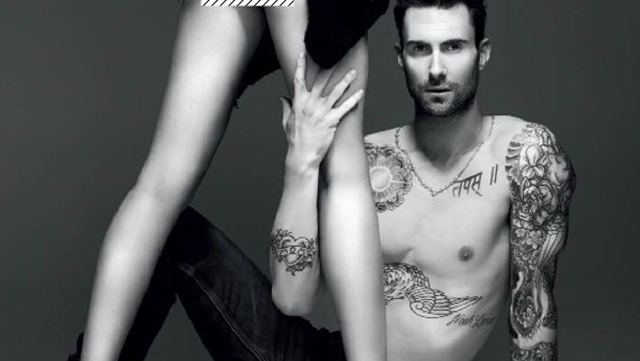 Where is the rest of Adam Levine's torso and his leg coming out of his stomach?