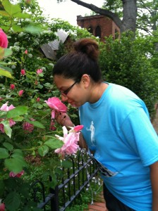 Katie stops and smells the roses during Run Big Dream Big IV.